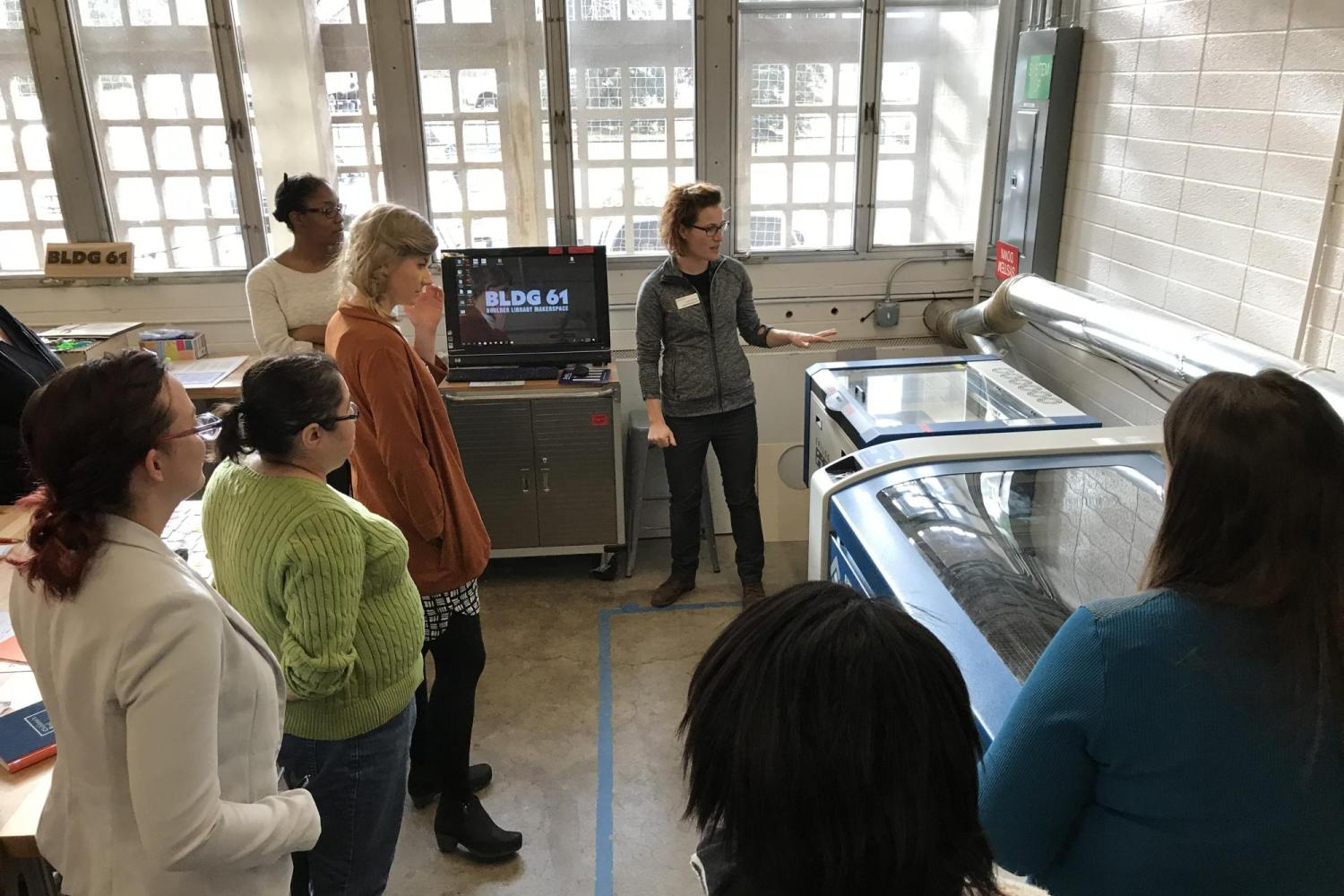 Librarians learn about a laser cutter during PD workshop.