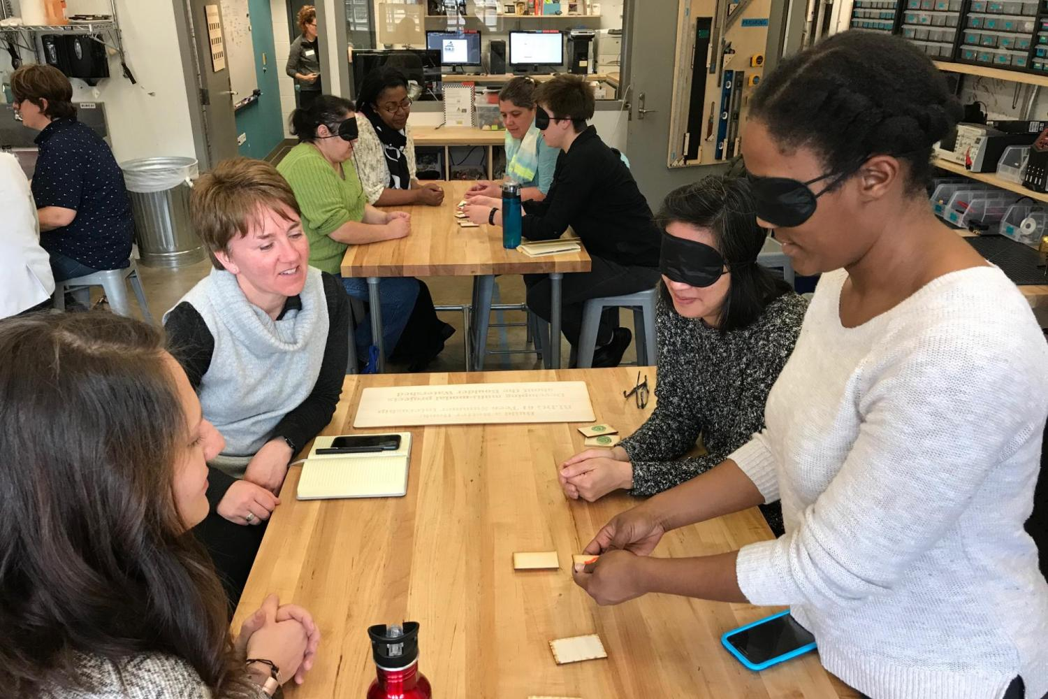 Librarians with blindfolds test a tactile Memory game.