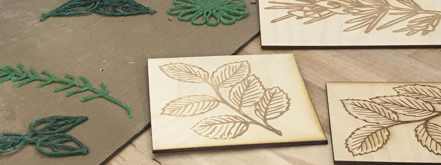 Laser cut prototypes of plant diagrams.