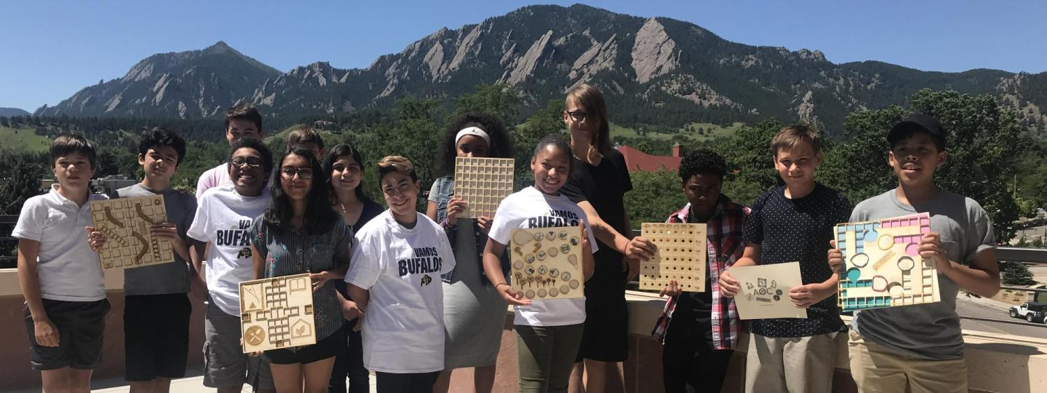Middle school students display tactile board games created in a Build a Better Book summer program.