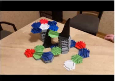 3D Printed marble run made up of hexagons with tracks