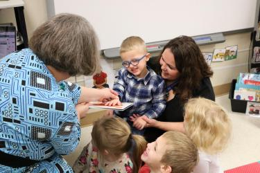Sharing a tactile board book with preschool students