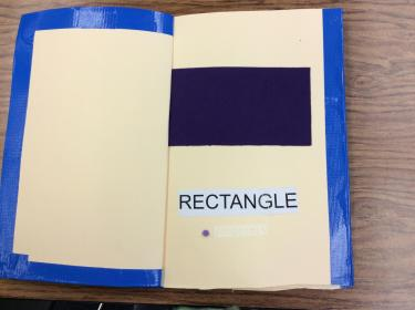 Page showing a large felt rectangle with braille and English label.