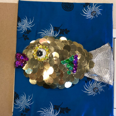 Tactile fish with large sequins scales and fabric tail.