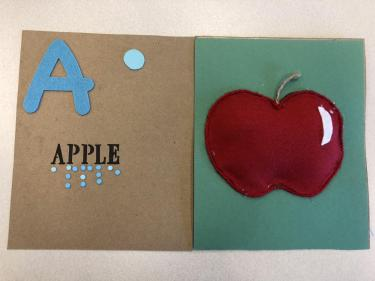 Book page for letter A showing a red felt apple.