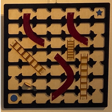Tactile gameboard for Chutes and Ladders with directional guided playing spaces.