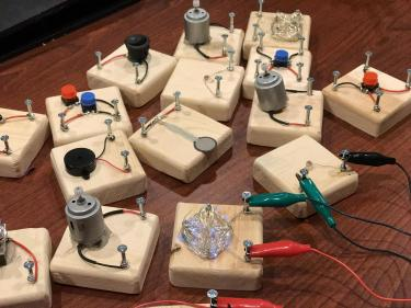 Wooden blocks with different components for creating circuits