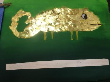 chameleon decorated with gold ribbon texture