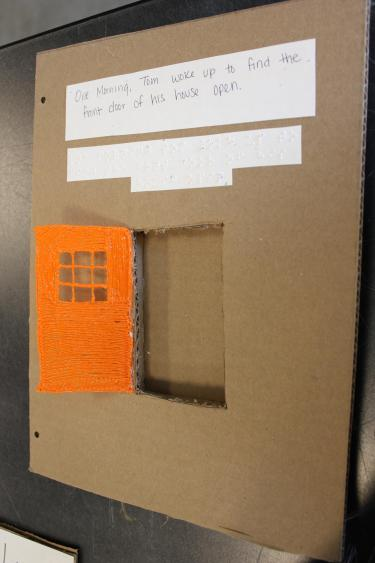 Sample book page showing a door drawn with a 3D pen that opens into a cut out in the page.