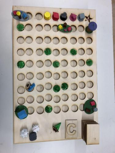 Enchanted Forest game board made from plywood with small round holes in a grid.