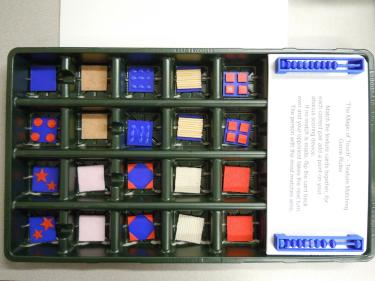 Board Game box showing tactile memory game pieces in a grid.