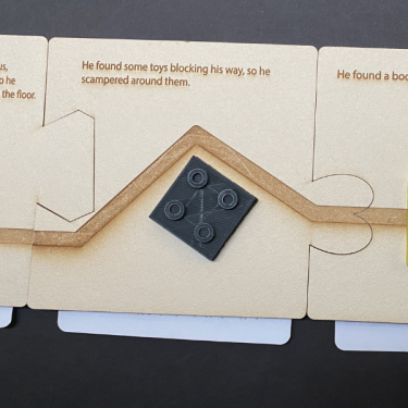 Board book pages attached together by puzzle cut outs on each page