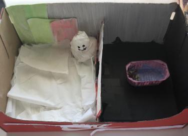 diorama of snowman and of boy in bathtub