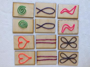 Tactile cards with raised symbols made from wax sticks