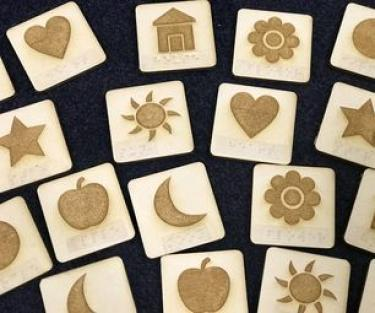 Tactile cards with embossed designs cut with a laser cutter