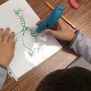 Student using 3D pen to trace characters from the book Sneetches by Dr. Seuss