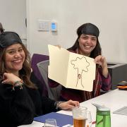 Analiza and Jackie showing their tactile tree drawing during the Build a Better Book workshop.