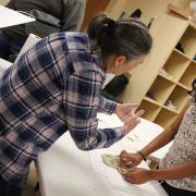 Ann Cunningham and Rishika Kartik working with clay