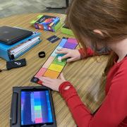 Girl working with iPad and Specdrum rings with color map