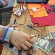 Student uses Makey Makey to add sound to Where the Wild Things Are picture book.