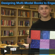 Teen participant displays his tactile book.