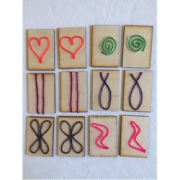 Wood cards with patterns made from wikkisticks.