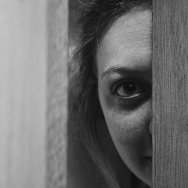 Face peeping through door gap