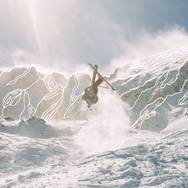 Person skiing in the mountains doing a flip