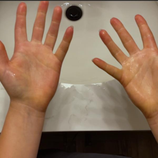 Hands over a bathroom sink