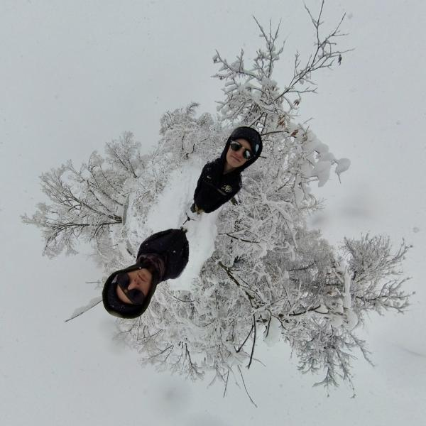 Mini-world view of artist and snowy landscape