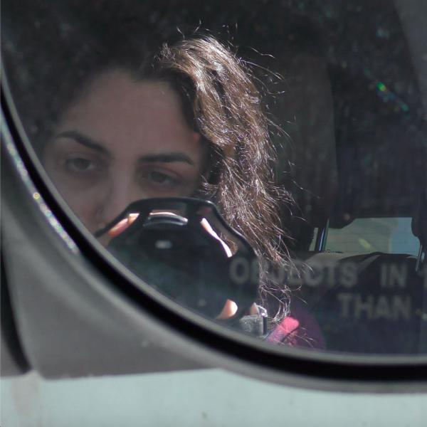 Artist in car with video camera