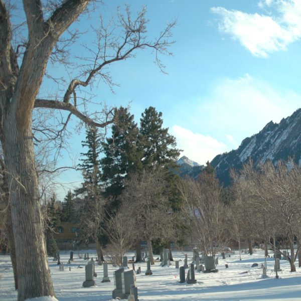 Cemetery in winter with the flat irons in the background