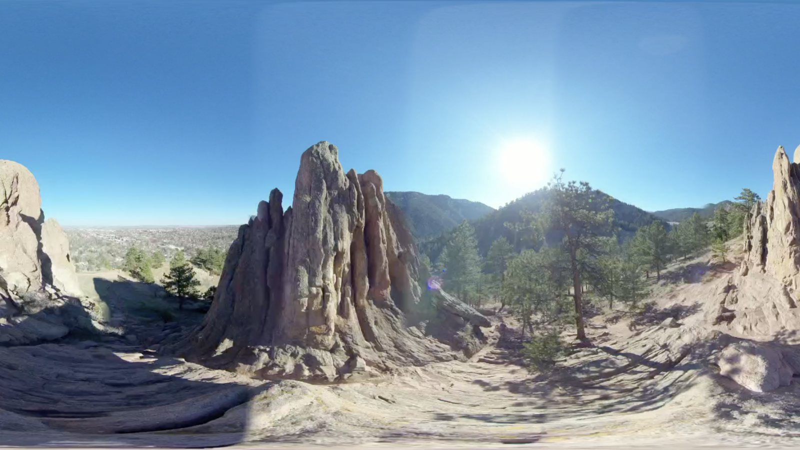 Red rocks landscape with blue sky and bright sun