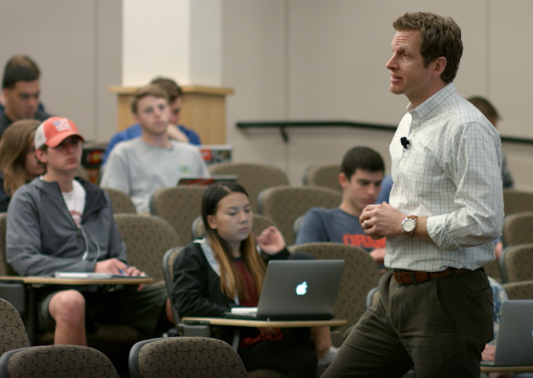 Photo of Matt Koschmann teaching a Communication class.