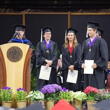 Student receiving awards at graduation