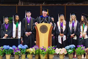 Professor Lewis O. Harvey, Jr., announces the honors graduates