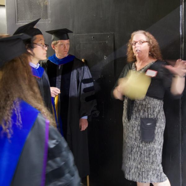 Lead Academic Advisor Laurel Amsel, in a flurry of hand-waving, herds the cats, PhDs (aka professors)