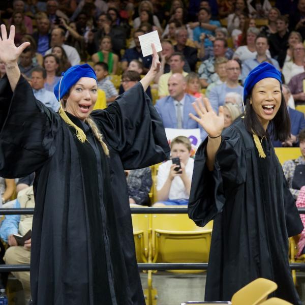 New PhDs Liz Woodruff and Lauren Chun are somewhat happy