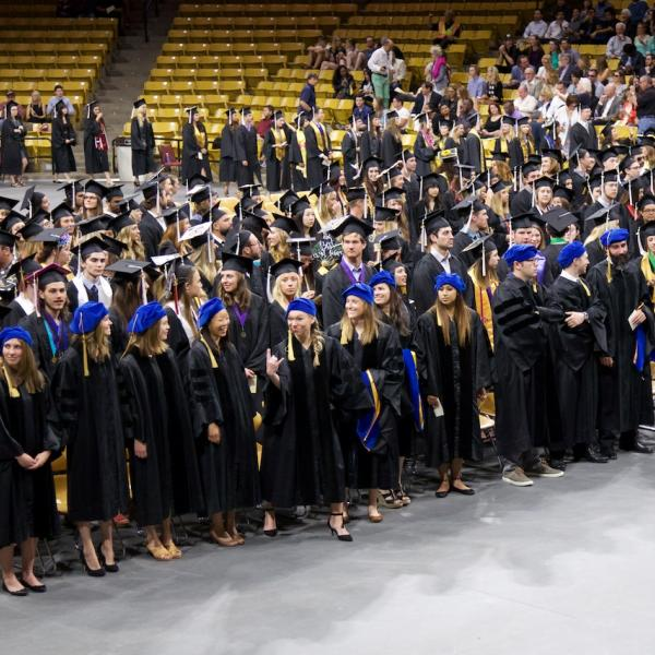 The PhDs (front row, floppy blue hats) took a whole row themselves