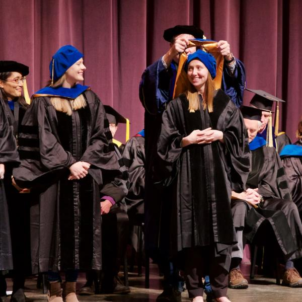 Jessica Mollick is hooded by her mentor Professor Randy O'Reilly