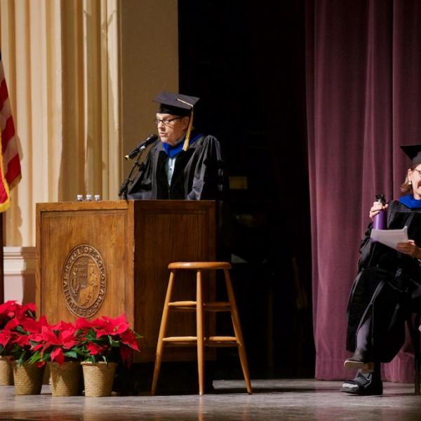Chair of the department Jerry Rudy addresses the graduates