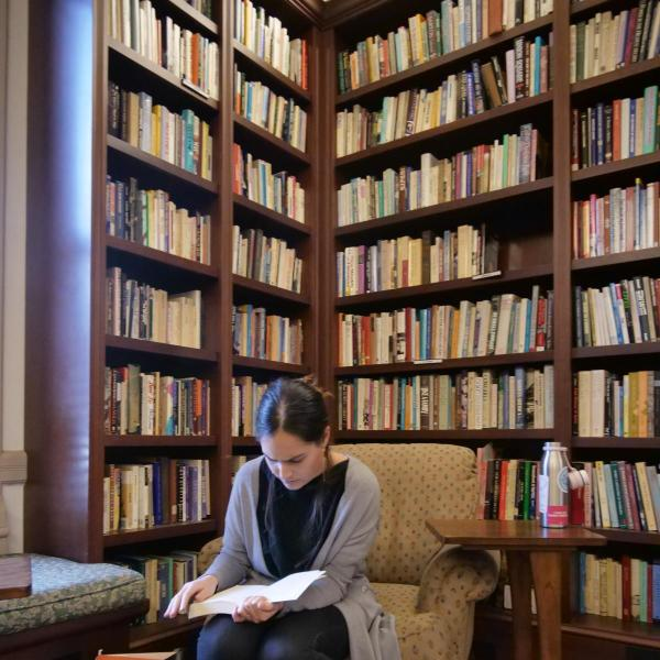 student studying in library, ostensibly in grad school