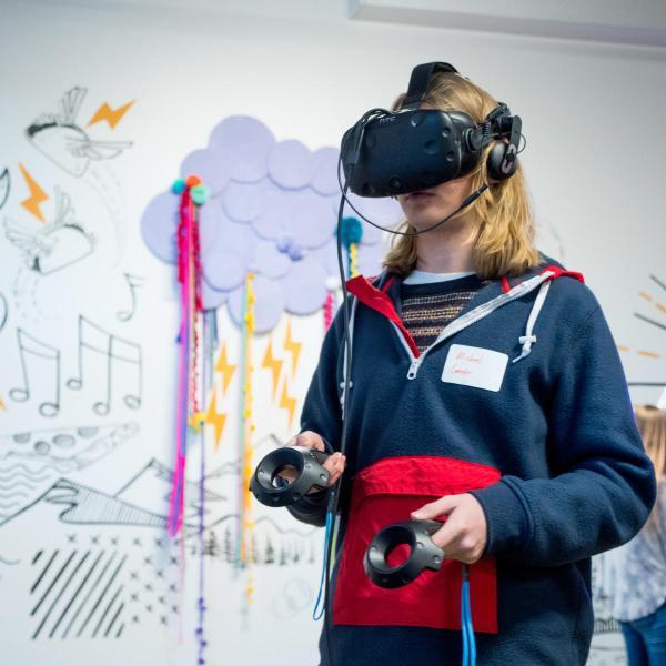 student using virtual reality glasses