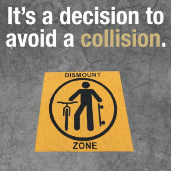 "Graphic encouraging bikers & skateboarders to ""walk their wheel"" in campus dismount zones. It's a decision to avoid a collision."