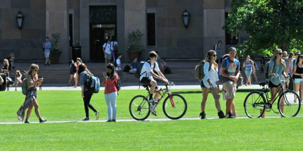 Pedestrians and bicyclists sharing a sidewalk by Norlin Quad