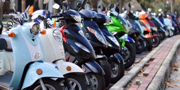 A line of parked mopeds