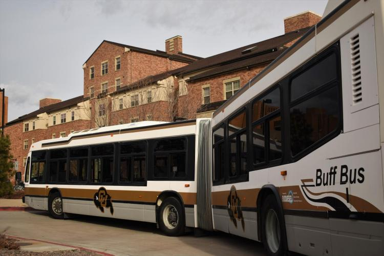 Photo of the Buff Bus in front of Bear Creek Apartments located on the CU Boulder campus