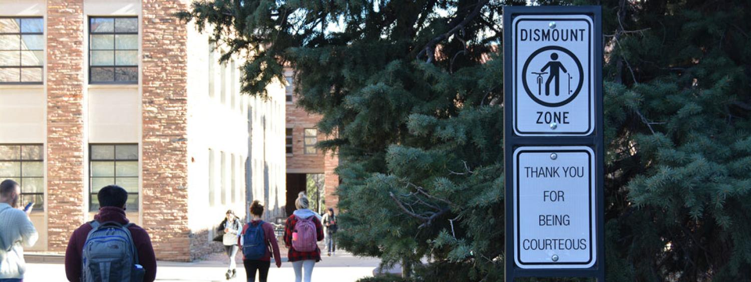 A dismount zone sign on CU campus.