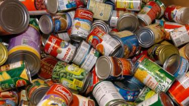 Photo of cans of donated food for Food for Fines