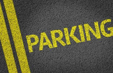 Parking stripes and the word Parking painted on asphalt